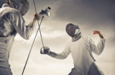 Two fencers facing each other — Stock Photo