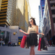 Beautiful woman carrying many shopping bags on a city street — Stok fotoğraf
