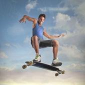 Smiling young man skateboarding — Stock Photo