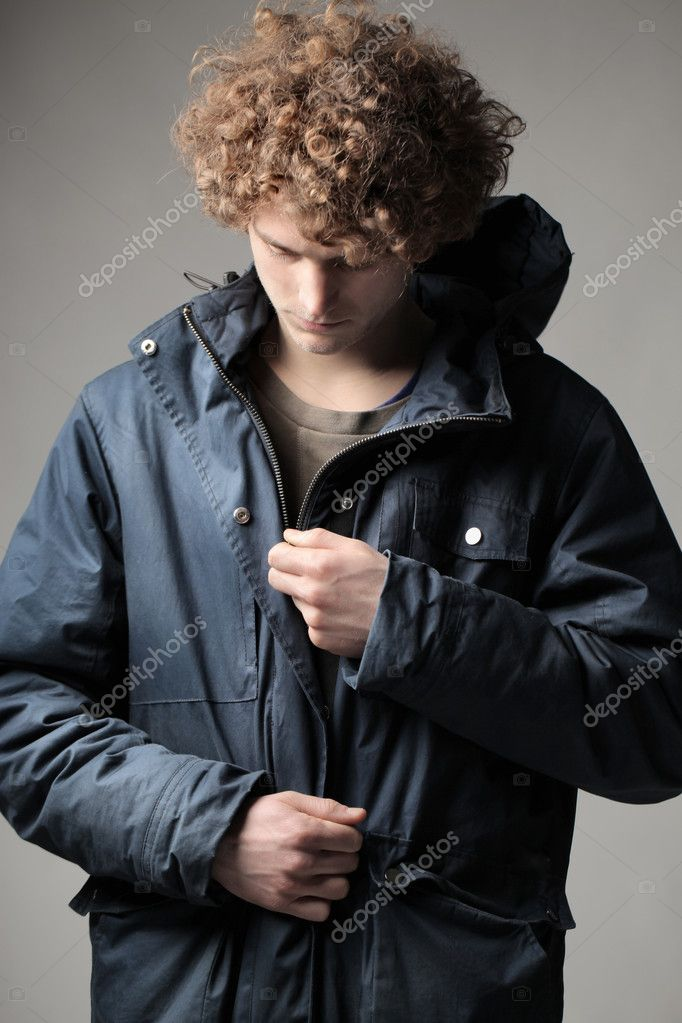 Young man closing his windcheater — Stock Photo #8731352