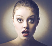 Beautiful woman with astonished expression — Stock Photo