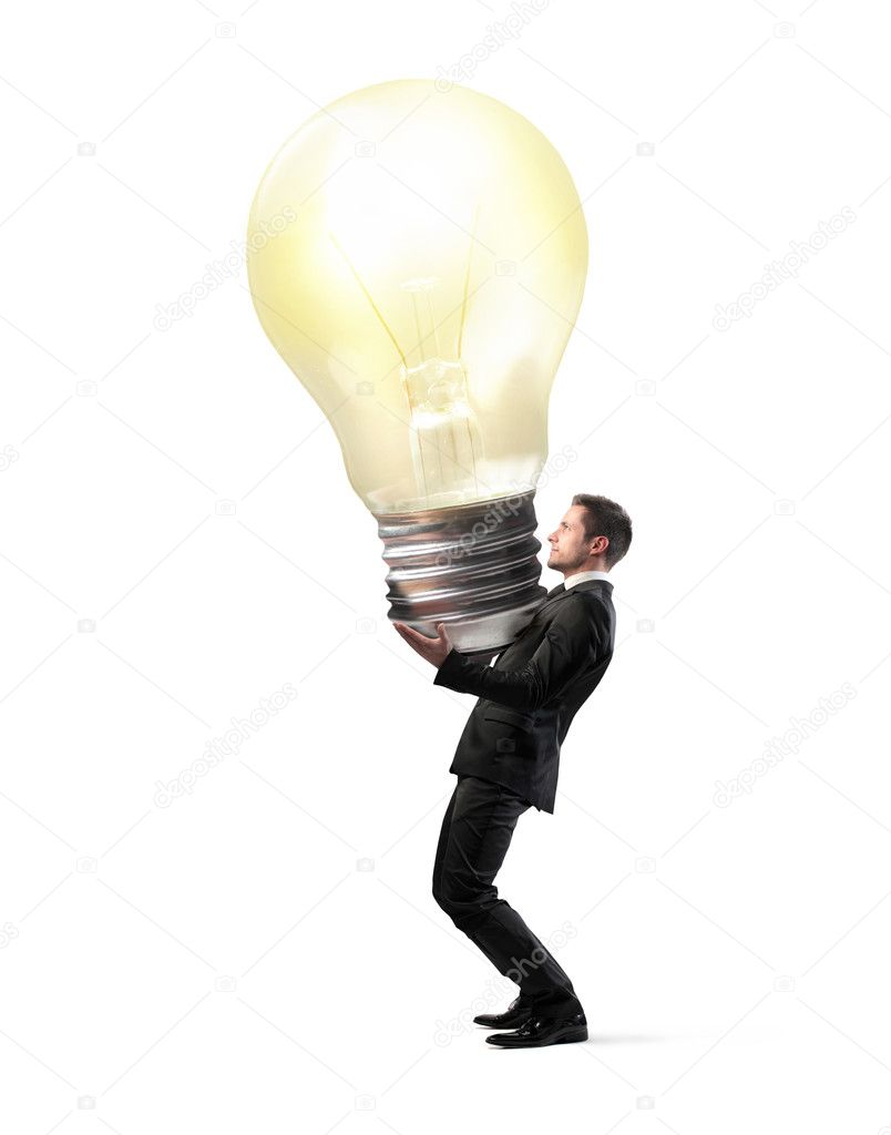 Businessman holding a giant light bulb  Stock Photo #9058779