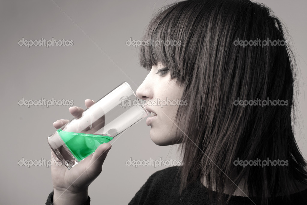 Young woman using some mouthwash  Stock Photo #9058958