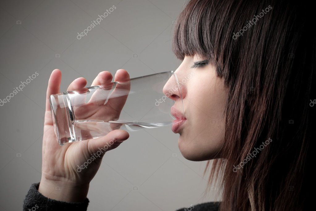 Beautiful woman drinking a glass of water — Stock Photo #9059231