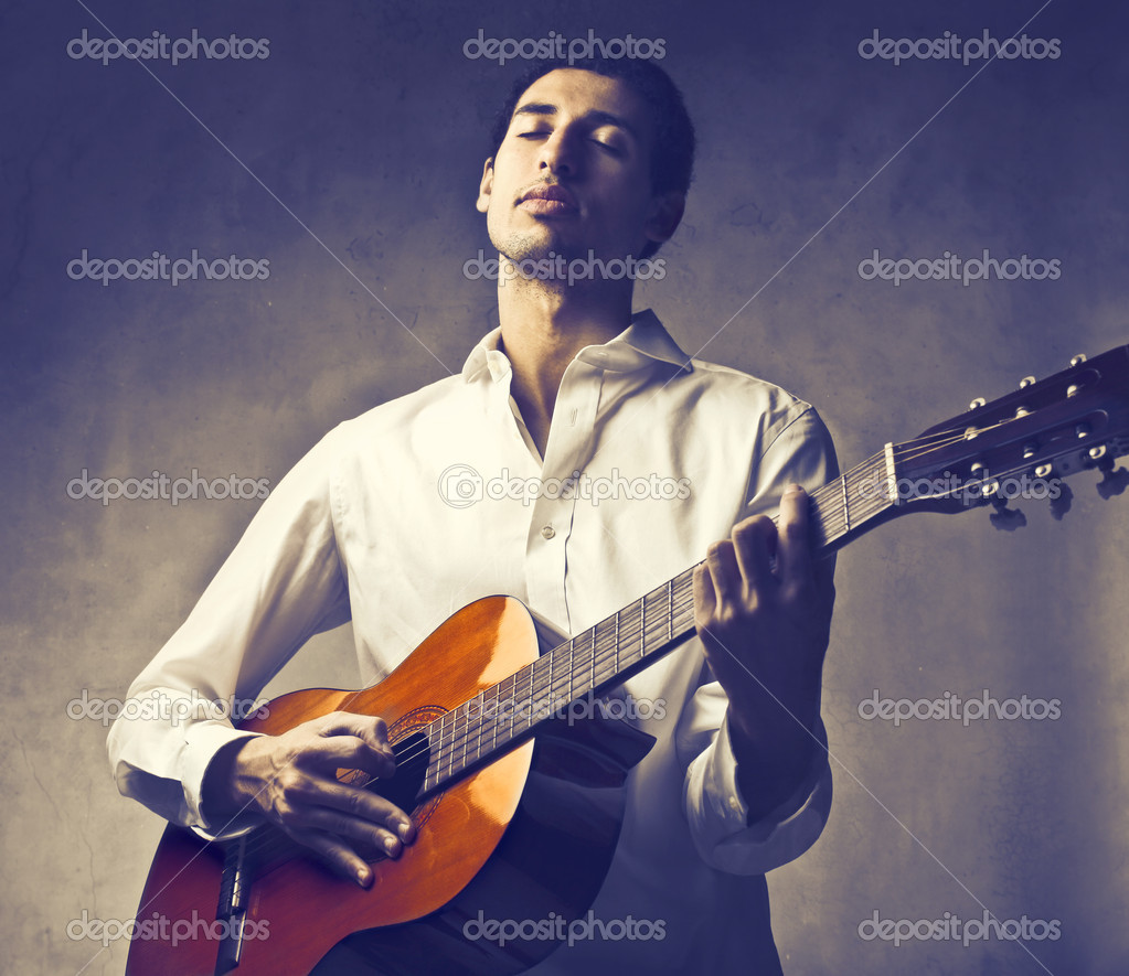Handsome young man playing guitar — Stock Photo #9059729