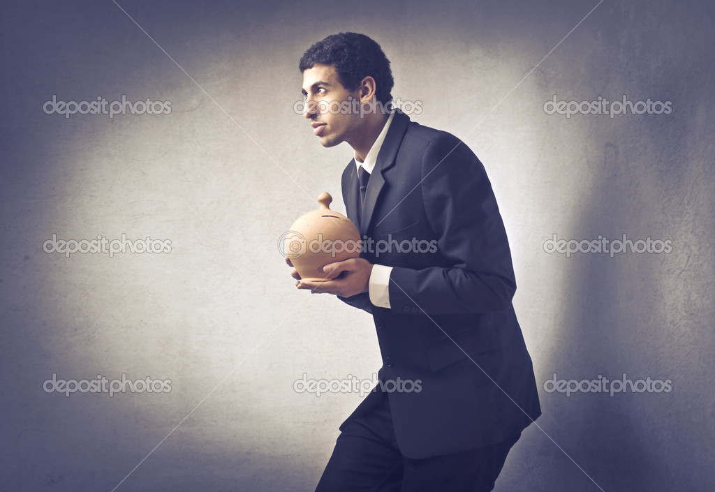 Sneaky businessman holding a money box — Stock Photo #9059868