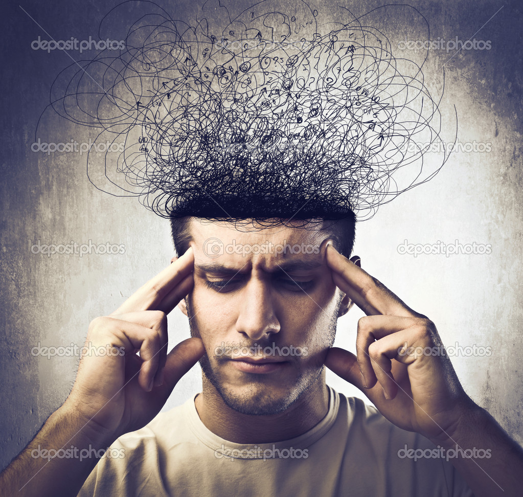 Concentrated young man with his head melting in tangled lines — Stock Photo #9137841