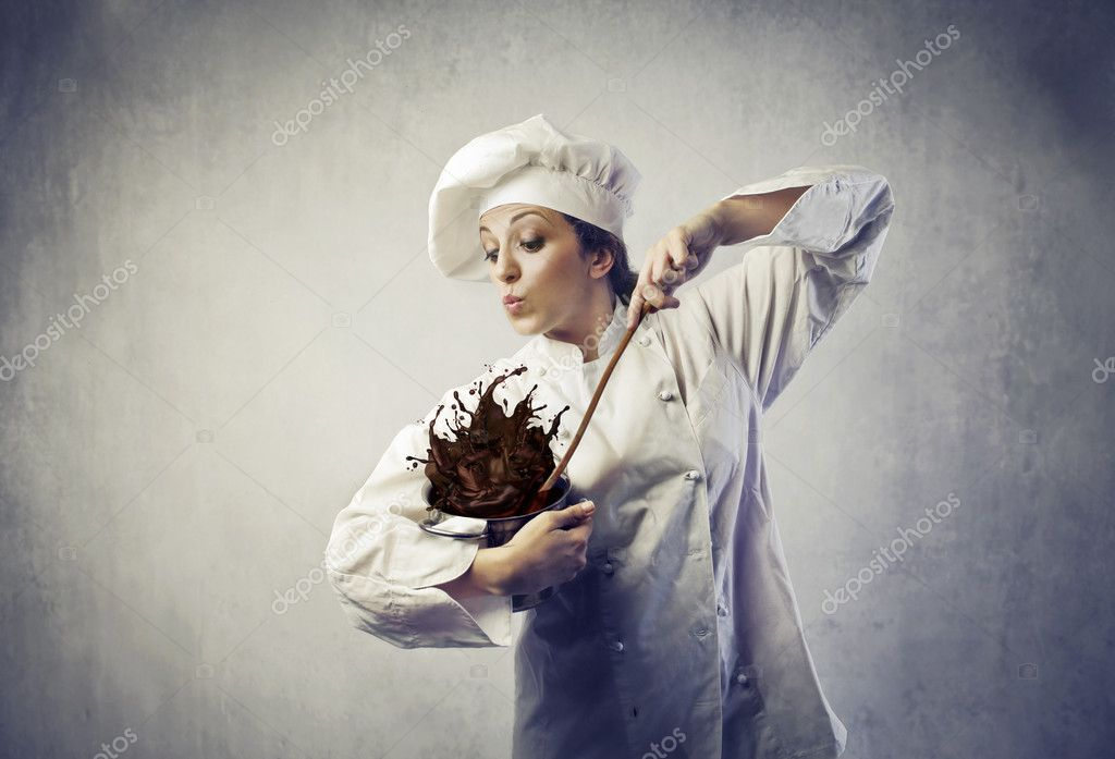 Funny female cook mixing food spilling from a pot — Stock Photo #9182737