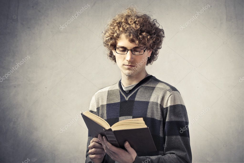 Young man reading a book — Stock Photo #9182938