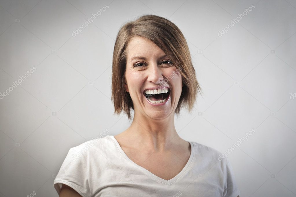 Portrait of a laughing woman  Stock Photo #9399946