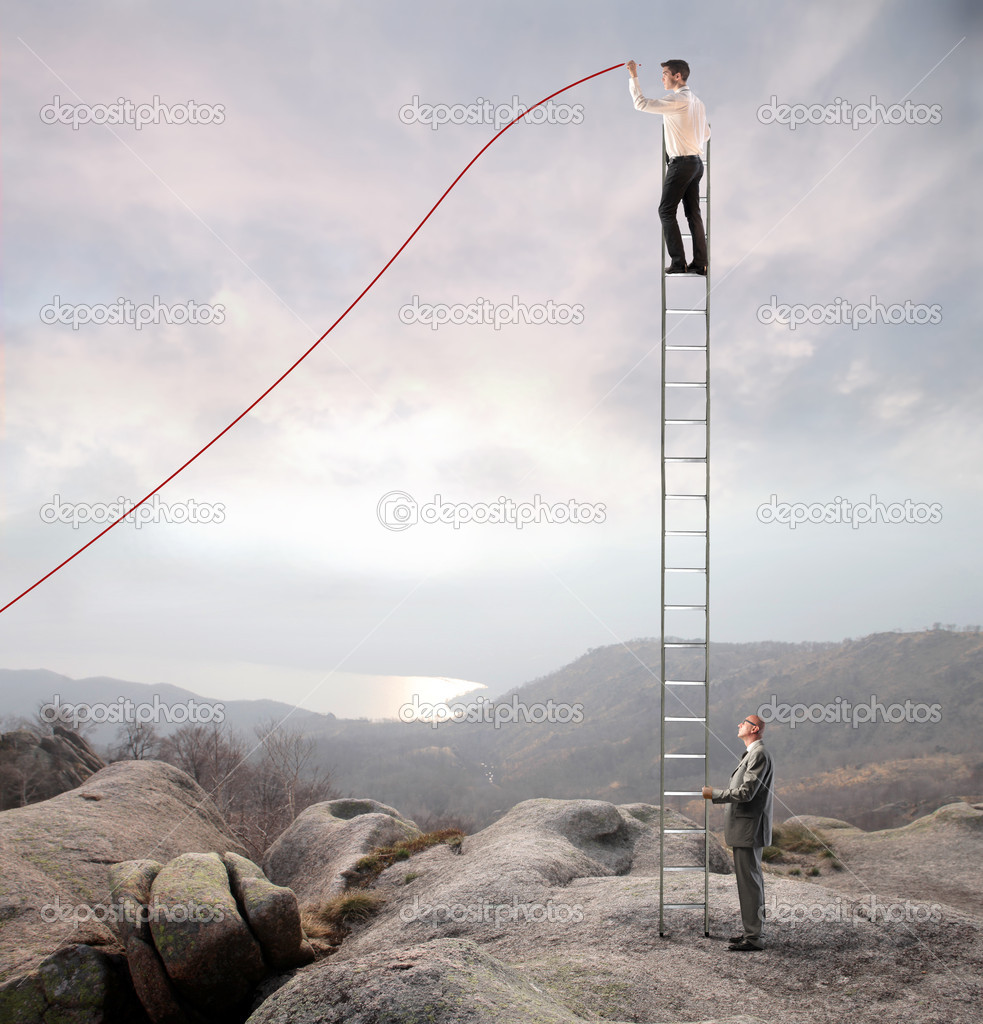 Young businessman on a ladder charting a positive trend graph with older businessman helping him to keep the balance — Stock Photo #9623443