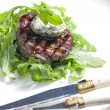 Foto Stock: Grilled beefsteak with herbal butter