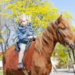 Little girl on horseback — Stock Photo #10308242