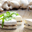 Cheese brie filled with roasted mushrooms - Stock Photo