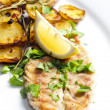 Grilled mackerel with roasted potatoes — Stock Photo