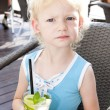 Portrait of little girl with a glass of cocktail — Stock Photo