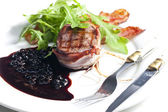 Beefsteak grilled in bacon with sauce of juniper and red wine — Stock Photo