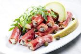 Parma ham rolls filled with cream cheese, Galia melon and capers — Stock Photo