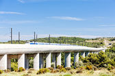 Train of TGV on railway viaduct near Vernegues, Provence, France — Stock Photo