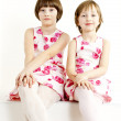 Stock Photo: Two sisters wearing similar dresses