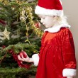 Little girl as Santa Claus — Stock Photo #8037035