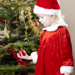 Stock Photo: Little girl as Santa Claus