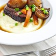 Beef stew with carrot and mashed potatoes - Stock Photo