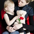 Mother with her little daughter holding teddy bear — Stock Photo