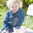 Foto Stock: Little girl at picnic