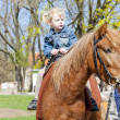 Little girl on horseback — Stok fotoğraf