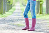 Detail of woman wearing rubber boots — Foto Stock