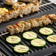 Meat skewers and vegetables on electric grill - Stock Photo