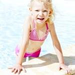 Little girl in swimming pool — Stock Photo #9970353