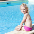 Stock Photo: Little girl at swimming pool