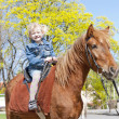 Little girl on horseback — Stock Photo #9970601