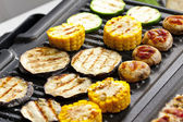 Vegetables on electric grill — Stock Photo