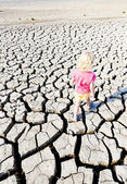 Little girl standing on dry land, Parc Regional de Camargue, Pro — Stock Photo