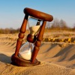Hourglass in desert — Stock Photo