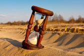 Hourglass in desert — Stock Photo