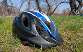 Helmet on grass — Stock Photo