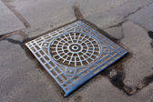 Manhole on road — Stock Photo