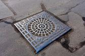 Manhole on road — Stock Photo