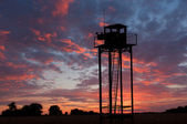 Watch tower on sunset sky — Stock Photo