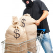 Happy robber with sack full of dollars — Stock Photo