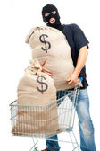 Happy robber with sack full of dollars — Stockfoto