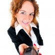 Businesswoman holds out a mobile phone. — Stock Photo #8132252
