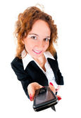 Businesswoman holds out a mobile phone. — Stock Photo