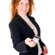 Business woman holds out her credit card — Stock Photo