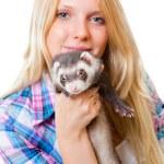 Girl kissing a ferret — Stock Photo #8753401
