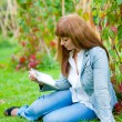 Young woman reading in tablet pc — Stock Photo #9137856